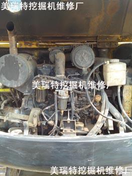 现代60-7挖掘机热车后行走无力故障分析